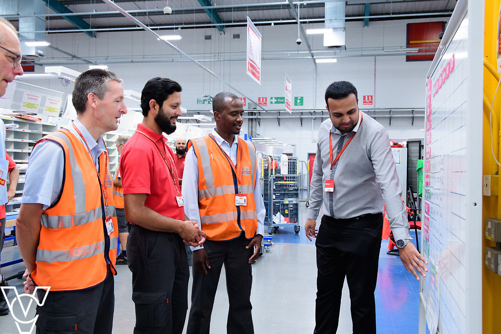 Two delivery offices, Oadby and Leicester South, which are both based inside the Leicester Mail Processing Unit building, have passed the penultimate gateway of One Plan.  One Plan is a business programme designed to have a standardised operation of excellence.  Pictured is Shahbaaz Khan, right, working with, from left, Keith Bedford, Ian Rosewarne, Shuaib Chowdhury and Collis Shepherd.<br /> <br /> Picture: Chris Vaughan Photography<br /> Date: July 7, 2017