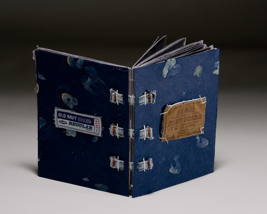 Artist: Matthew Reedy. Book sewn on tapes from blue jean pants and decorated paper cover.