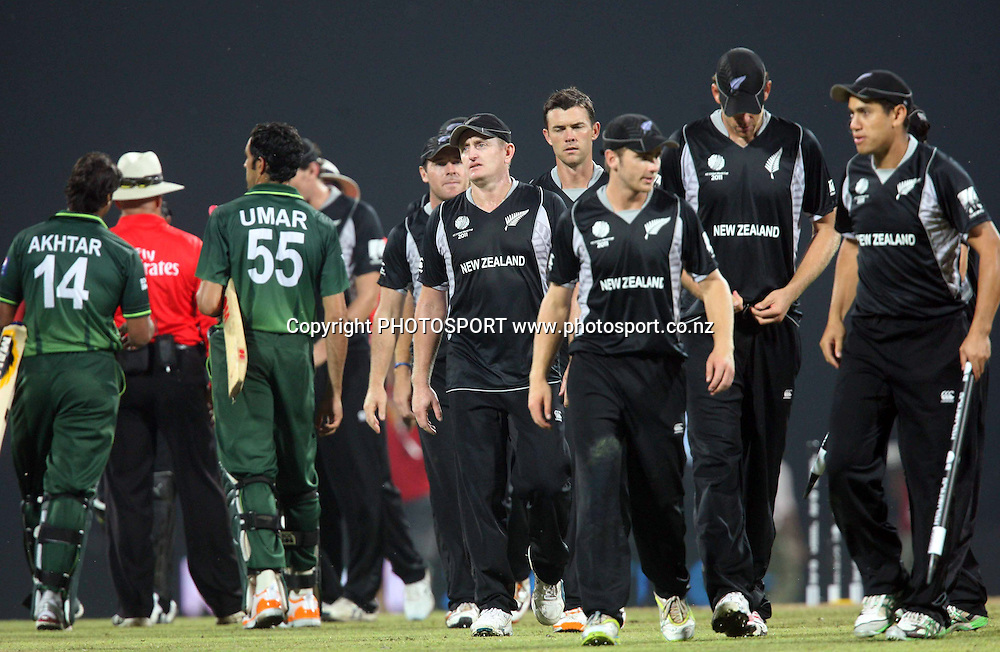 The Black Caps walk off the pitch after beating Pakistan. ICC Cricket World Cup. New Zealand vs Paksitan. Pallekele Cricket Stadium, Kandy, Sri Lanka. Tuesday 8 March 2011. Photo: photosport.co.nz