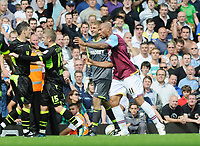 Football - West ham United v Leeds United John Carew (West ham) argues with Adam Clayton (15)22/08/2011 Credit : Colorsport / Andrew Cowie