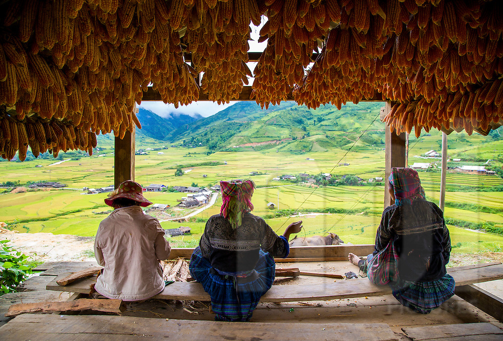 A group of women sit under a shelter in Mu Cang Chai, Vietnam, Southeast Asia