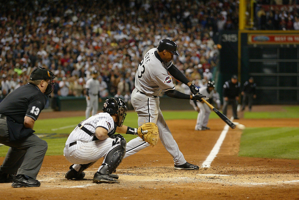 HOUSTON - OCTOBER 26:  Jermaine Dye #23 of the Chicago White Sox hits a game winning (and World Series winning) single to score Willie Harris in the eighth inning during Game 4 of the 2005 World Series against the Houston Astros at Minute Maid Park on October 26, 2005 in Chicago, Illinois.  The White Sox defeated the Astros 1-0.