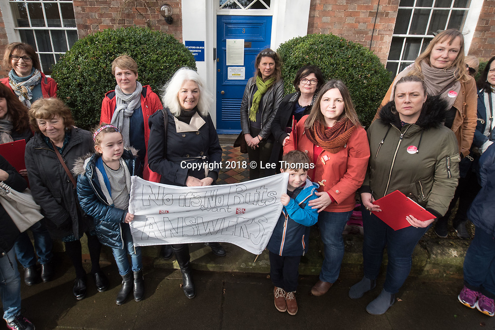 "3 Trinity Street, Stratford-upon-Avon, Warwickshire, UK. 28th January 2018. A group of protesters hold a demonstration outside the Conservative constituency office in Stratford-Upon-Avon calling for local MP Nadhim Zahawi to quit his Children and families ministerial post. Calling it a 'Women's Protest' the demonstration was organised by Stratford Labour Women who say they have called the protest to show support to Shadow Education Secretary Angela Rayner who has written an open letter to Government counterpart Damian Hinds, saying ""serious questions remain unanswered"" about Mr Zahawi's attendance at the controversial Presidents Club Ball. Pictured:  Protesters gather outside Stratford-Upon-Avon's Conservative Party constituency office. // Lee Thomas, Tel. 07784142973. Email: leepthomas@gmail.com  www.leept.co.uk (0000635435)"