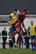 Croydon Athletic striker Louis Blake and Hollands and Blair Captain Stuart West compete for the header during the Southern Counties East match between AFC Croydon Athletic and Hollands & Blair at the Mayfield Stadium, Croydon, United Kingdom on 10 October 2015. Photo by Mark Davies.