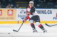 KELOWNA, CANADA - DECEMBER 5: Sam Ruopp #2 of Prince George Cougars skates with the puck against the Kelowna Rockets on December 5, 2014 at Prospera Place in Kelowna, British Columbia, Canada.  (Photo by Marissa Baecker/Shoot the Breeze)  *** Local Caption *** Sam Ruopp;