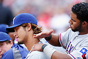 BOSTON, MA - AUGUST 8: Elvis Andrus #1 of the Texas Rangers offers up a short massage session to pitcher Yu Darvish #14 during a game against the Boston Red Sox at Fenway Park on August 8, 2012 in Boston, Massachusetts. The Rangers won 10-9. (Photo by Joe Robbins)