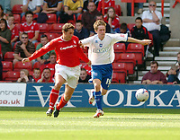 Photo: Leigh Quinnell.<br /> Nottingham Forest v Brighton & Hove Albion. Coca Cola League 1. 19/08/2006. Brightons Jake Robinson holds off Forests Grant Holt.