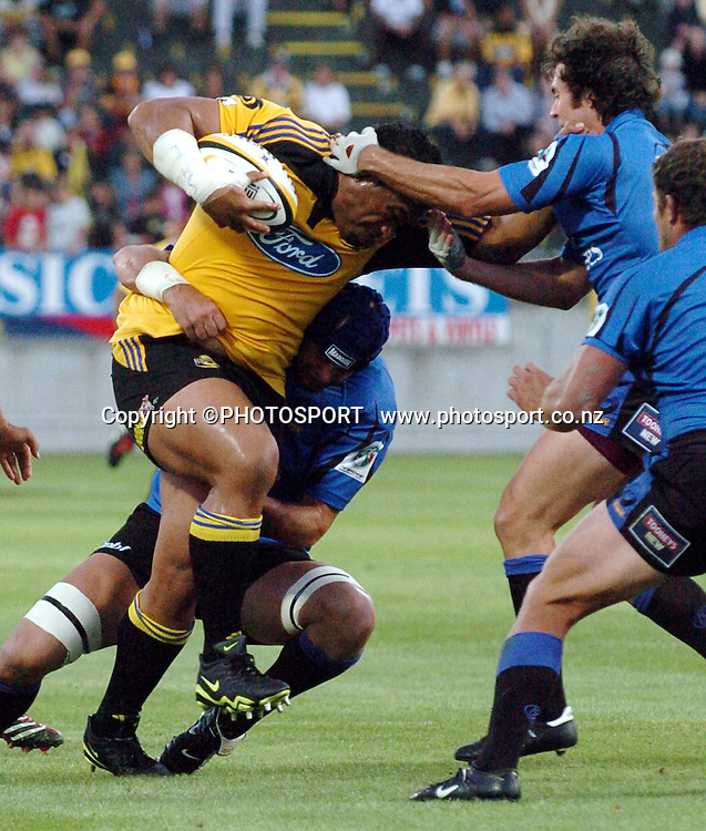 Neemia Tialata hits the tackle during the 2006 Super 14 rugby union match between the Hurricanes and the Western force at Yarrow Stadium, New Plymouth, on Saturday 18 February, 2006. Photo: John Cowpland/PHOTOSPORT