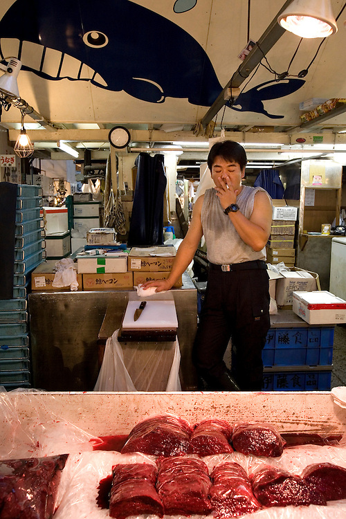 Shop selling wale meat from wales that is said they have been killed for scientific reasons. Tsukiji fish market  is the biggest wholesale fish and seafood market in the world and also one of the largest wholesale food markets of any kind. The market is located in Tsukiji in central Tokyo, and is a major attraction for foreign visitors.