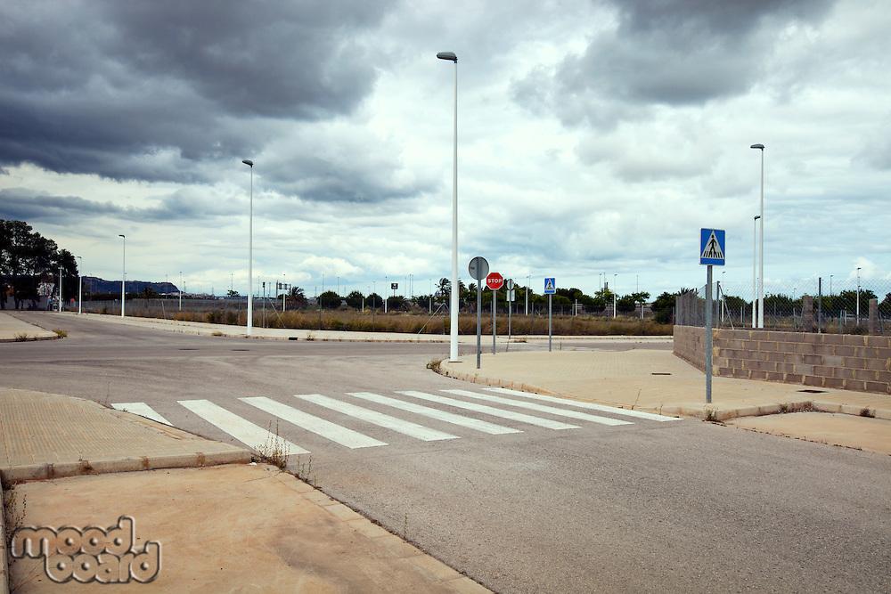 Cross roads in abandoned estate building site, Valencia region, Spain