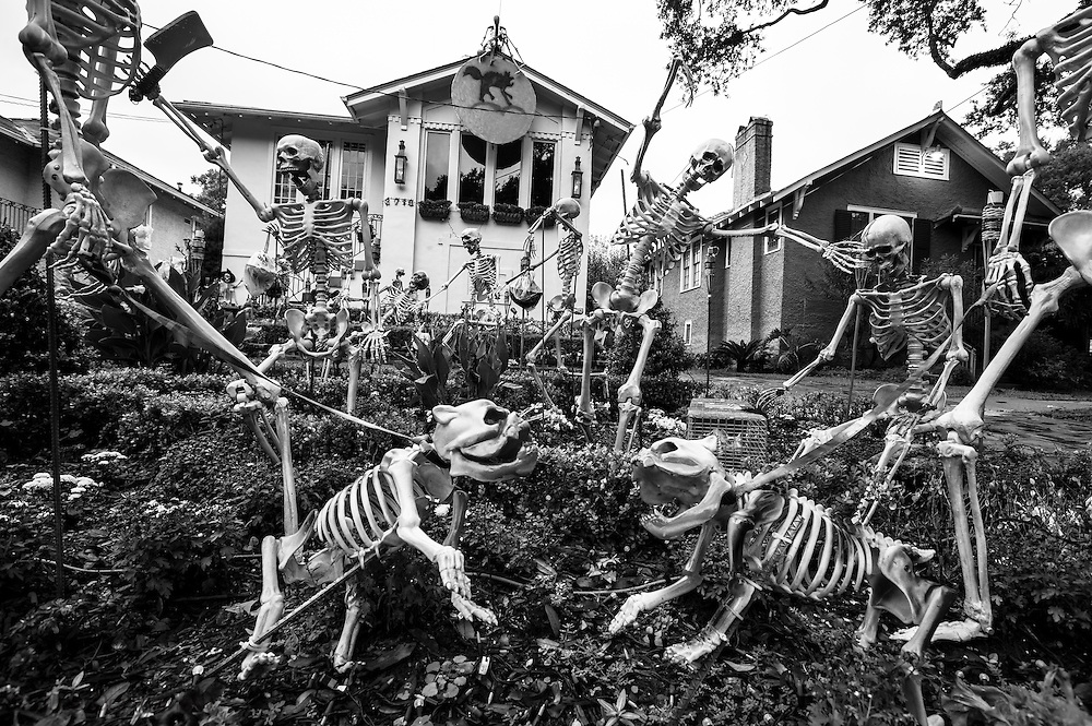 Halloween decorations at a house on State Street in New Orleans.  Full scale skeletons of people with their dogs fill the lawn of a home in uptown New Orleans.
