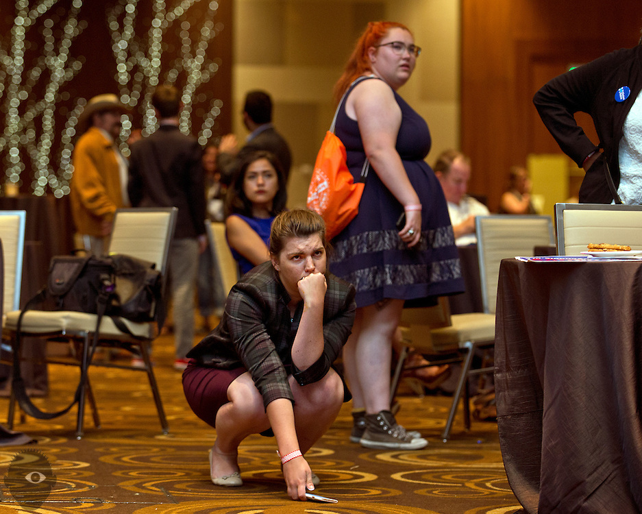Some of many attendees who are emotional as Donald Trump takes the stage on television as the Nevada State Democratic Party hosts its 2016 election night watch party with Hillary for Nevada and down-ballot Democratic candidates in Southern Nevada at ARIA Resort and Casino on Tuesday, Nov. 8, 2016. L.E. Baskow
