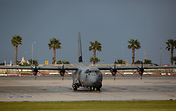 A British Royal Air Force C-130 Hercules transport plane is seen at Malta International Airport outside Valletta February 23, 2011. The plane arrived in Malta on Wednesday morning in readiness to fly to Libya to evacuate British nationals..Photo by Darrin Zammit Lupi