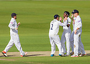 Fidel Edwards (Hampshire CCC) is congratulated after taking the wicket of Mark Stoneman  (Durham County Cricket Club) during the LV County Championship Div 1 match between Durham County Cricket Club and Hampshire County Cricket Club at the Emirates Durham ICG Ground, Chester-le-Street, United Kingdom on 1 September 2015. Photo by George Ledger.