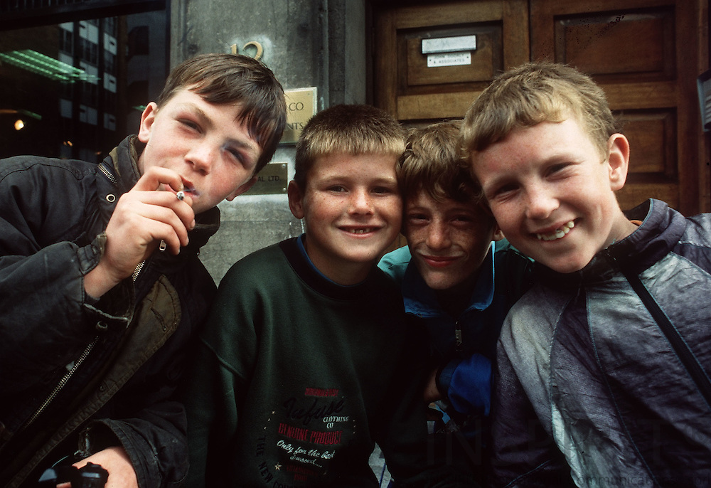 Four boys smoking cigarettes at the streets of  Dublin in the autumn of 1993.   Photo: Erik Luntang