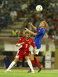BELGRADE, SERBIA & MONTENEGRO - Wednesday, August 20, 2003: Wales' Robbie Savage and Serbia & Montenegro's Zvonimir Vukic during the UEFA European Championship qualifying match at the Red Star Stadium. (Pic by David Rawcliffe/Propaganda)