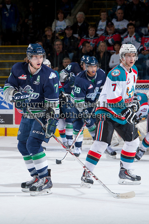KELOWNA, CANADA - APRIL 3: Mitch Elliot #7 of the Seattle Thunderbirds and Damon Severson #7 of the Kelowna Rockets stand on the ice on April 3, 2014 during Game 1 of the second round of WHL Playoffs at Prospera Place in Kelowna, British Columbia, Canada.   (Photo by Marissa Baecker/Getty Images)  *** Local Caption *** Mitch Elliott; Damon Severson;