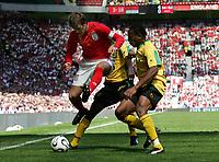 Photo: Paul Thomas.<br /> England v Jamaica. International Friendly. 03/06/2006.<br /> <br /> David Beckham (L) of England is put under pressure by Shane Crawford and Garfield Reid (R).