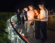 LOWER MAKEFIELD, PA -  SEPTEMBER 11:  From left, Christian Berger, 14, Alex Berger, 18, Suzanne Tortorici and Nick Berger pause at the site of Suzanne's husband and the boys father's name at the Garden of Reflection 9/11 Memorial service September 11, 2013 in Lower Makefield, Pennsylvania. (Photo by William Thomas Cain/Cain Images)