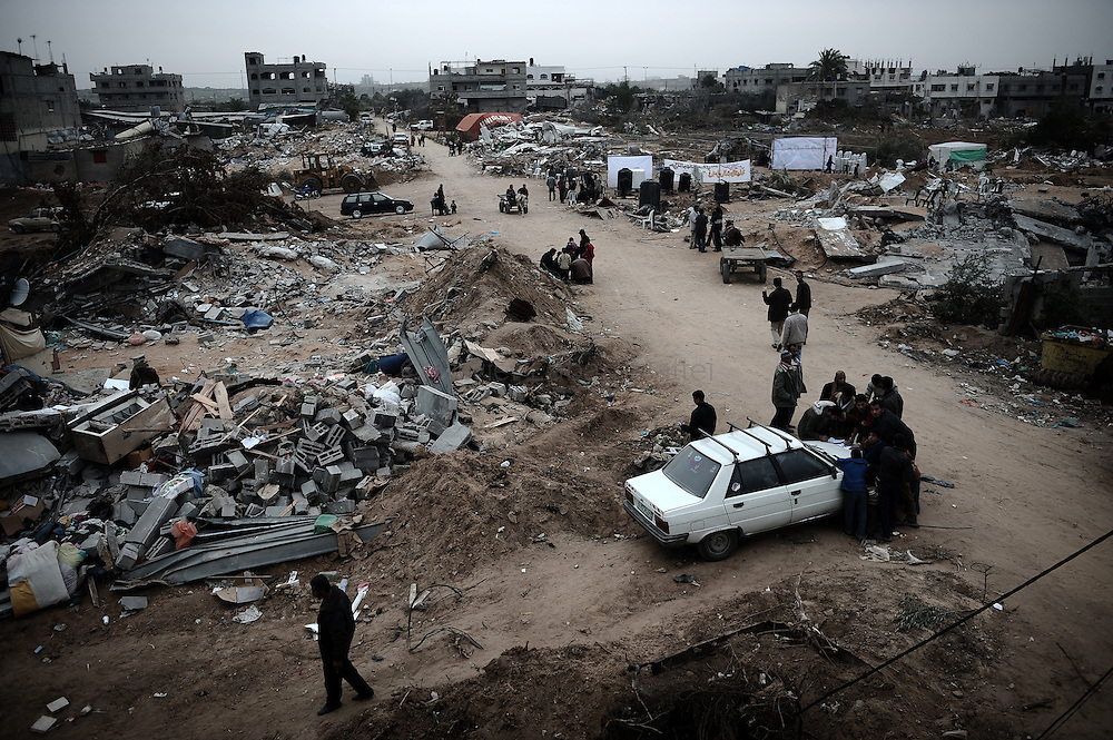Palestinians inspect the Israeli-bombed Zeitun district of Gaza City on January 23, 2009. A Hamas delegation from Gaza crossed into Egypt for talks to shore up the ceasefire with Israel which ended a 22-day assault on the coastal strip, a border official said. Israel and Hamas have observed their own ceasefires since January 18 when Israel ended Operation Cast Lead leaving a trail of devastation and 1,330 Palestinians dead, according to doctors. Egypt is trying to secure a durable ceasefire between Israel and Hamas and the reopening of crossings.