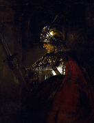 A Man in Armour', 1655. Oil on canvas.  Rembrandt van Rijn (1606– 1669 ) Dutch painter and etcher. Helmet Cuirass Lance Shield Cloak Red Profile