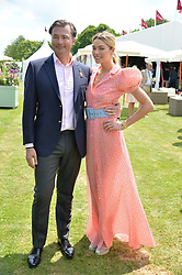 Jessica Hart and Laurent Feniou at Cartier Queen's Cup Polo, Guard's Polo Club, Berkshire, England. 18 June 2017.<br /> Photo by Dominic O'Neill/SilverHub 0203 174 1069 sales@silverhubmedia.com