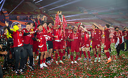 LIVERPOOL, ENGLAND - Wednesday, July 22, 2020: Liverpool's Fabio Henrique Tavares 'Fabinho' celebrates with the Premier League trophy after the Reds are crowned Champions after the FA Premier League match between Liverpool FC and Chelsea FC at Anfield. The game was played behind closed doors due to the UK government's social distancing laws during the Coronavirus COVID-19 Pandemic. Liverpool won 5-3. (Pic by David Rawcliffe/Propaganda)