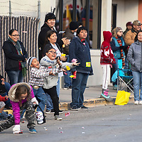 (Left to right) Patrick James, 7, and his cousin Hailei Jim, 10, try to catch candy thrown at them during the Christmas parade downtown, Saturday Nov. 1 in Gallup as part of the Red Rock Balloon Rally.