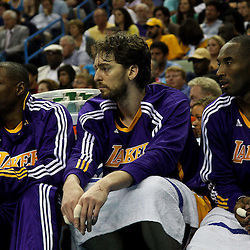 April 24, 2011; New Orleans, LA, USA; Los Angeles Lakers players Theo Ratliff (50), Pau Gasol (16) and Kobe Bryant (24) watch from the bench during the fourth quarter in game four of the first round of the 2011 NBA playoffs against the New Orleans Hornets at the New Orleans Arena. The Hornets defeated the Lakers 93-88.   Mandatory Credit: Derick E. Hingle