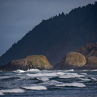 View of the Pacific Ocean waves and the rock stacks of Ecola State Park taken from Cannon Beach, Oregon.
