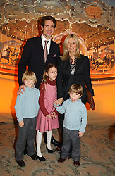 CROWN PRINCE PAVLOS and PRINCESS MARIE CHANTAL OF GREECE with their children, left to right, PRINCE CONSTANTINE, PRINCESS OLYMPIA and PRINCE ACHILEAS at a children's party in aid of the charity Over The Wall held at Fortnum & Mason, Piccadilly, London before a gala premiere of the new musical Mary Poppins at The Prince of Wales Theatre, Old Compton Street, London W1<br /><br />NON EXCLUSIVE - WORLD RIGHTS