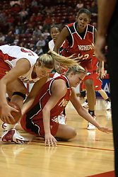 26 November 2005: Holly Hallstrom out muscles Jennifer Uptmor for a loose ball. The Illinois State Redbirds were triumphant over the Northern Illinois Huskies 60 - 50 at the final buzzer.  The game was played at Redbird Arena on the campus of Illinois State University in Normal IL