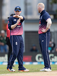 England's Eoin Morgan, left, signals for a DRS review against New Zealand as Ben Stokes looks on in the fourth one day cricket international at the University of Otago Oval, Dunedin, New Zealand, Wednesday, March 7, 2018. Credit:SNPA / Adam Binns ** NO ARCHIVING**