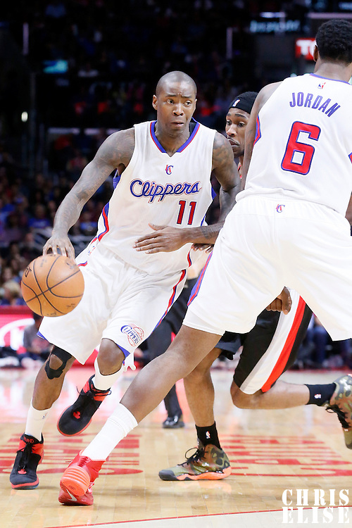 08 November 2014: Los Angeles Clippers guard Jamal Crawford (11) drives past Portland Trail Blazers guard Will Barton (5) on a screen set by Los Angeles Clippers center DeAndre Jordan (6) during the Los Angeles Clippers 106-102 victory over the Portland Trail Blazers, at the Staples Center, Los Angeles, California, USA.