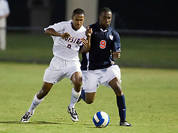 Virginia Cavaliers forward Matt Mitchell (9) and Hofstra defender Richard Martinez (9) battle for possession.  The Virginia Cavaliers faced the Hofstra Pride  in NCAA men's soccer at Klockner Stadium on the Grounds of the University of Virginia in Charlottesville, VA on September 7, 2008