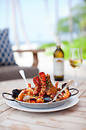 The Four Seasons Resort Hualalai at Historic Kaupulehu on the Big Island of Hawaii. The signature Chef Nick's Seafood Paella - For Two at the Beach Tree Restaurant.