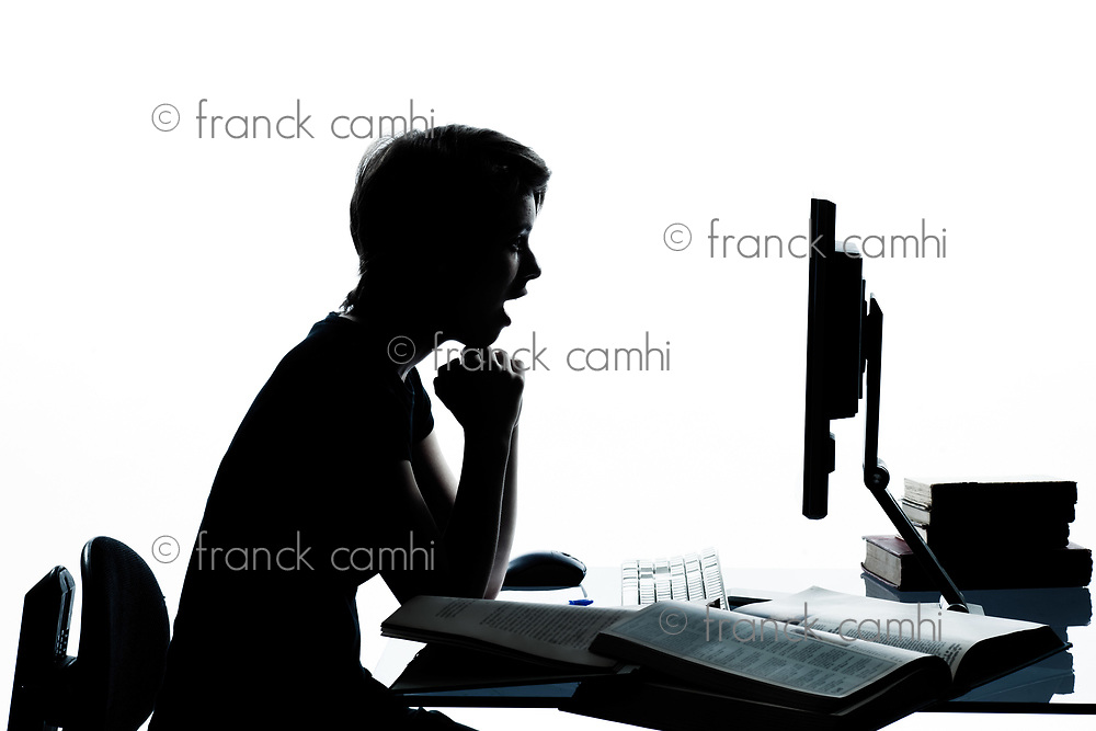 one caucasian young teenager silhouette boy or girl studying with computer computing laptop in studio cut out isolated on white background