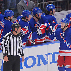 May 16, 2012: New York Rangers center Derek Stepan (21) high fives teammates at the bench after a goal during second period action in game 2 of the NHL Eastern Conference Finals between the New Jersey Devils and New York Rangers at Madison Square Garden in New York, N.Y.