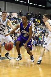 30 December 2006: Isiah Thomas reaches for the ball. The Titans outscored the Britons by a score of 94-80. The Britons of Albion College visited the Illinois Wesleyan Titans at the Shirk Center in Bloomington Illinois.<br />