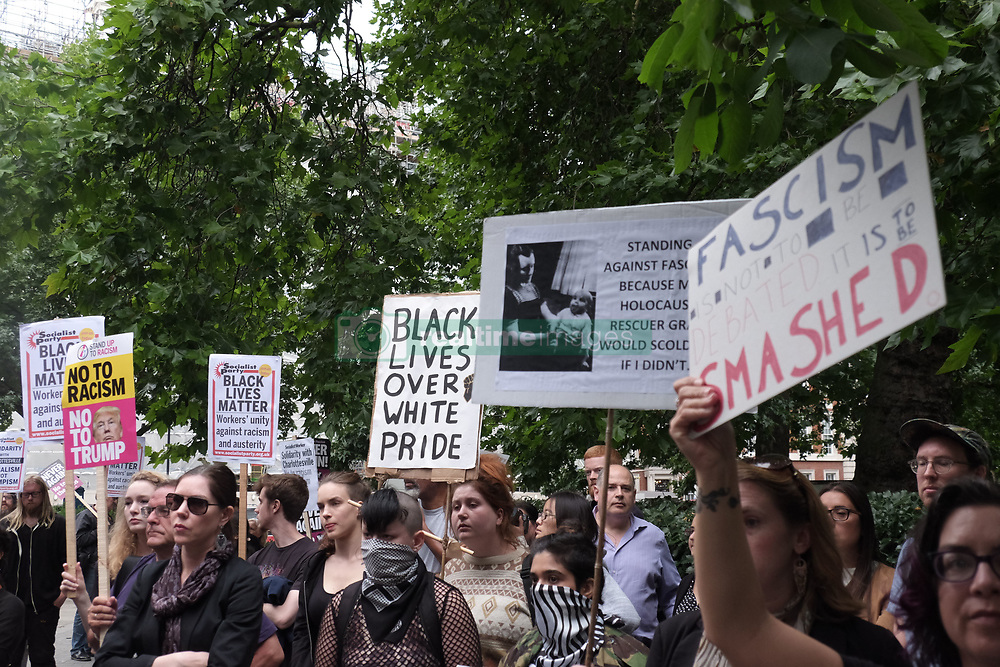August 14, 2017 - London, England, United States - People gather to stage a demonstration as they hold placards during the 'Stand up to Racism' protest outside the US Embassy in London on August 14, 2017. Anti-racism group stages protest outside the US Embassy following the murder of activist Heather Heyer at a counter-protest to a far-right during recent protests in Charlottesville, Virginia. (Credit Image: © Jay Shaw Baker/NurPhoto via ZUMA Press)