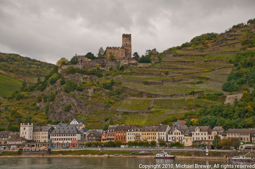 Germany, River Rhine. Hillside castle and shoreline town along the river in Southern Germany - horiz.