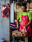 22 AUGUST 2018 - GEORGE TOWN, PENANG, MALAYSIA:  A butcher in the morning market on Campbell Street near the Campbell Street Market in George Town. It's one of the original wet markets in George Town.     PHOTO BY JACK KURTZ
