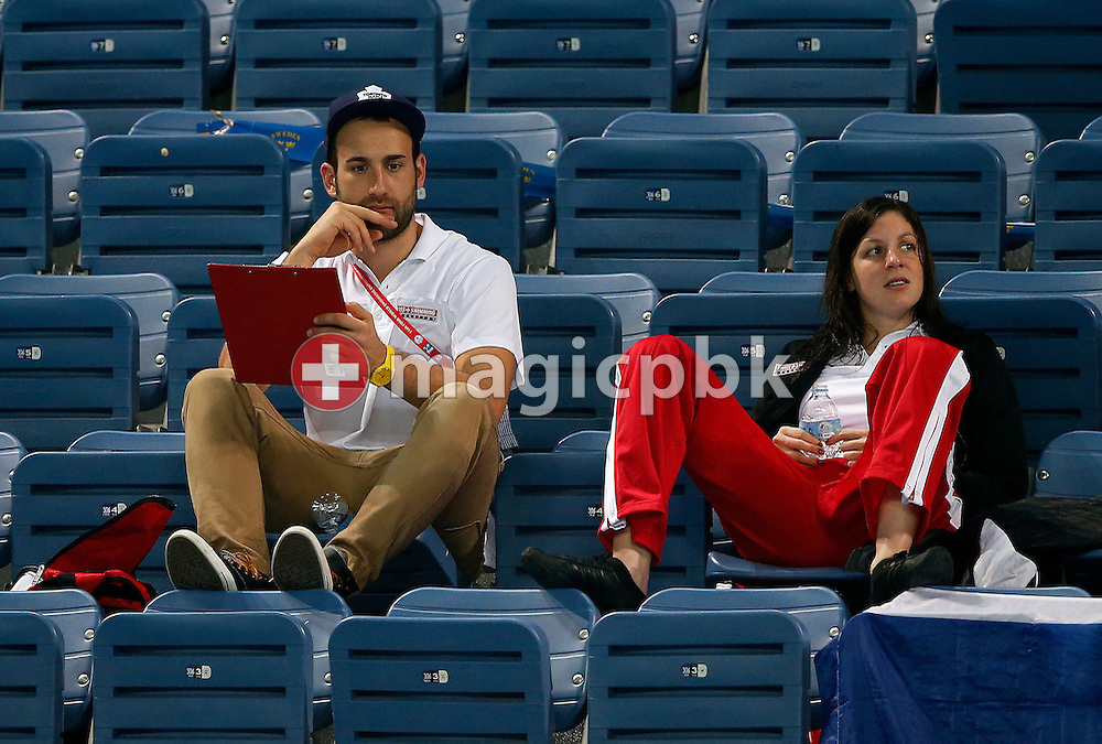 (L-R) Luka Gabrilo, Team Manager of the Swiss Team, and Danielle VILLARS of Switzerland follow the races during the 11th Fina World Short Course Swimming Championships held at the Sinan Erdem Arena in Istanbul, Turkey, Thursday, Dec. 13, 2012. (Photo by Patrick B. Kraemer / MAGICPBK)