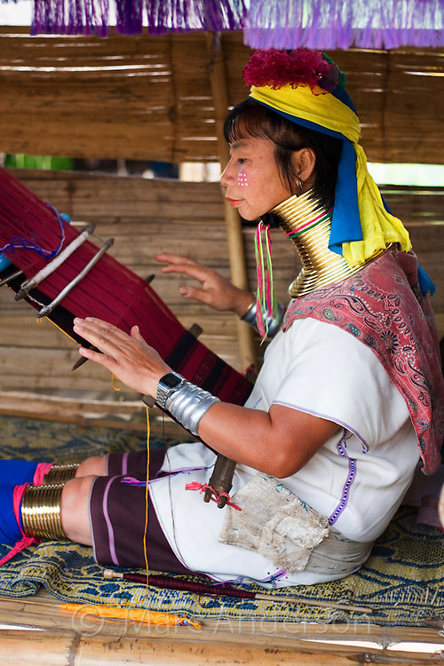 Woman from the Padaung long neck hill tribe weaving and wearing traditional dress, Tha Ton, Chiang Mai Province, Thailand