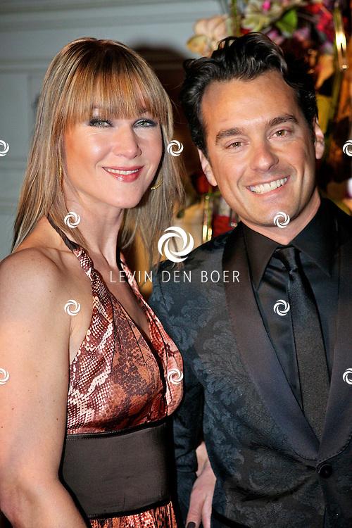 AMSTERDAM - In het Amstel Hotel zijn de Beau Monde Awards 2011 weer uitgereikt.  Met op de foto Rik Van de Westelaken en een vriendin. FOTO LEVIN DEN BOER - PERSFOTO.NU