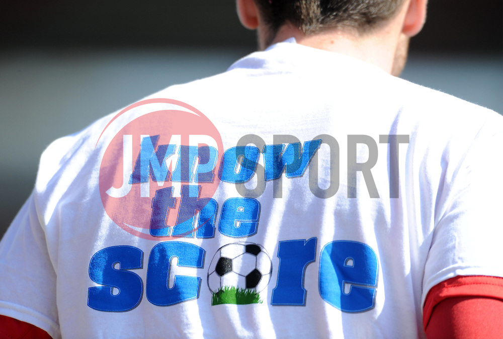 Know the Score shirts are worn by both sets of teams prior to kick off to raise awareness for bowel cancer. - Photo mandatory by-line: Harry Trump/JMP - Mobile: 07966 386802 - 06/04/15 - SPORT - FOOTBALL - Sky Bet League Two - Exeter City v Newport County - St James Park, Exeter, England.