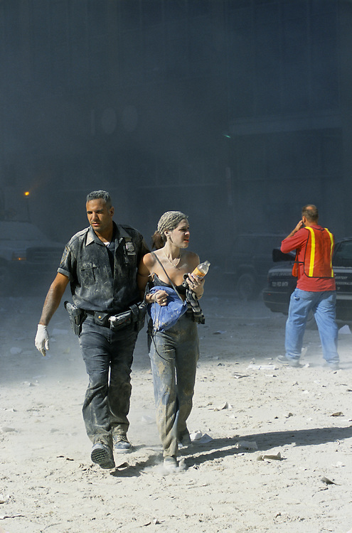 Rescuers, wounded people and debris  fill the streets of lower Manhattan after the Twin Towers were brought down by a terrorist attack on the World Trade Center, New York City, September 11, 2001. Photo by Lisa Quinones