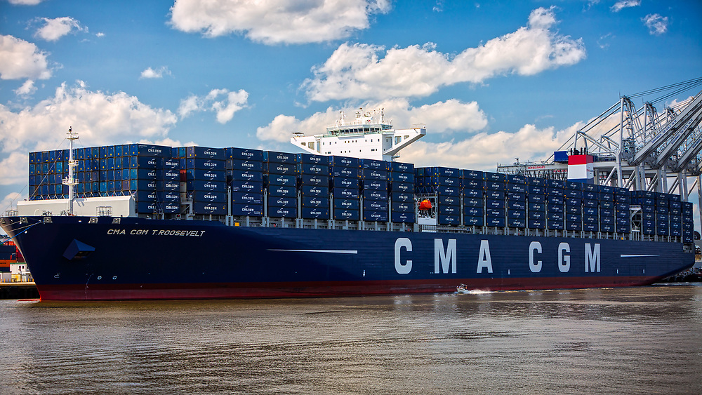 The Moran Tugboat Cooper Moran escorts the 14,000 TEU container ship CMA CGM Theodore Roosevelt as it pulls away from the docks at the Georgia Ports Authority Garden City Terminal before heading down the Savannah River, Sunday, Sept., 3, 2017, Garden City, Ga.  (GPA Photo/Stephen Morton)