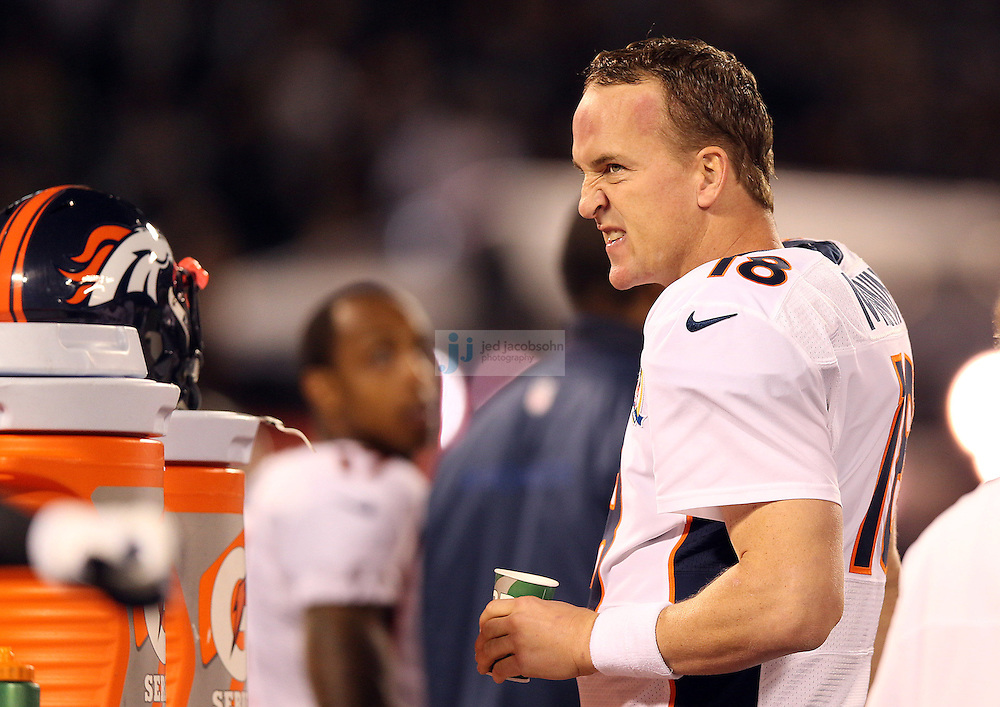 Denver Broncos quarterback Peyton Manning (18) drinks a cup of Gatorade against the Oakland Raiders during an NFL game on Sunday, December 6, 2012 at the Oakland Coliseum in Oakland, Ca.  (photo by Jed Jacobsohn)