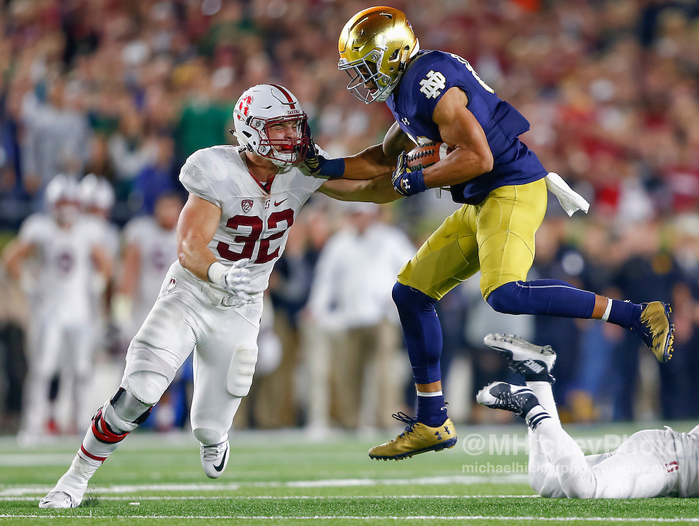 SOUTH BEND, IN - OCTOBER 15: Chase Claypool #83 of the Notre Dame Fighting Irish runs the ball after a reception as Joey Alfieri #32 of the Stanford Cardinal moves in for the tackle at Notre Dame Stadium on October 15, 2016 in South Bend, Indiana. Stanford defeated Notre Dame 17-10. (Photo by Michael Hickey/Getty Images) *** Local Caption *** Chase Claypool; Joey Alfieri
